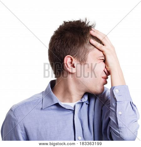 Fail. Frustrated man with facepalm gesture on white isolated studio background, side view