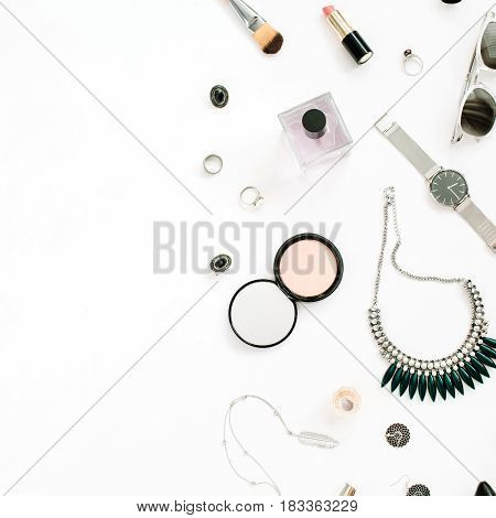 Beauty blog concept. Female make up accessories: watches necklace lipstick shoes sunglasses on white background. Flat lay top view trendy fashion feminine background.