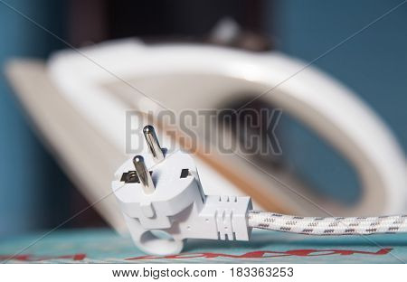 white electric iron cable plug close uo