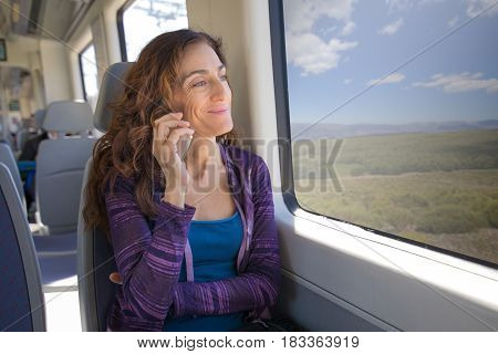 Smiling Woman In Train Listen To Mobile