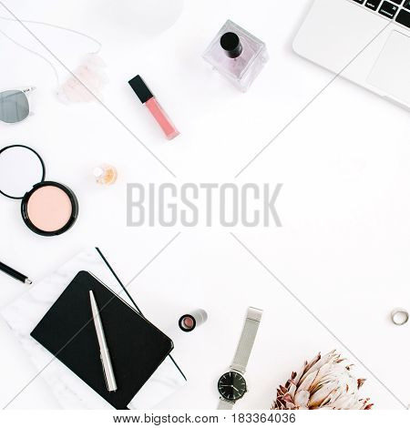 Blogger or freelancer frame workspace with laptop protea flower notebook and feminine accessories on white background. Flat lay top view minimalistic decorated home office desk. Beauty blog concept.