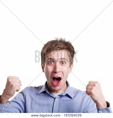 Winner celebrates. Great success. Excited man with happy facial expression shout on white isolated studio background