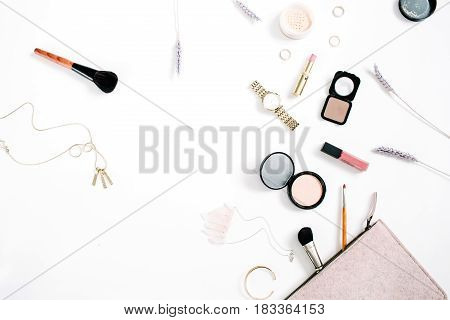 Beauty blog concept. Professional female make up accessories: watches necklace lipstick brush powder on white background. Flat lay top view trendy fashion feminine background.