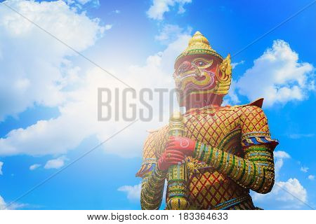 The Big Giant guardian statue on blue sky with cloud background in Thai TempleThailand.