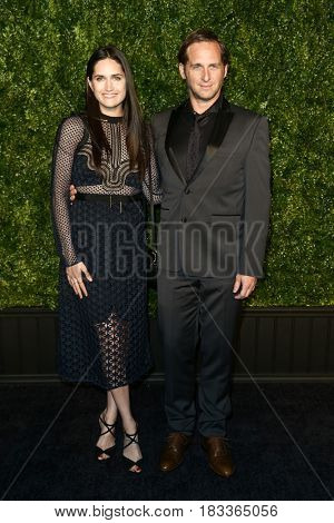 NEW YORK-APR 24: Josh Lucas (R) and Jessica Ciencin Henriquez attend the 12th Annual Tribeca Film Festival Artists Dinner hosted by Chanel at Balthazar Restaurant on April 24, 2017 in New York City.