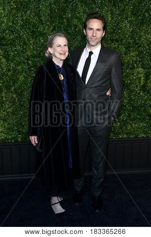 NEW YORK-APR 24: Alessandro Nivola (R) and Virginia Nivola attend the 12th Annual Tribeca Film Festival Artists Dinner hosted by Chanel at Balthazar Restaurant on April 24, 2017 in New York City.