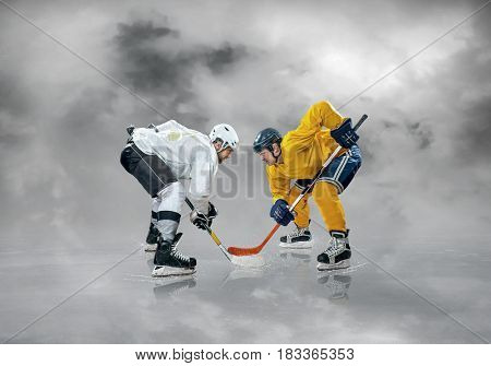 Ice hockey players in action on the ice under sky with clouds, outdoors