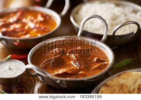 lamb tikka masala in balti dish shot with selective focus
