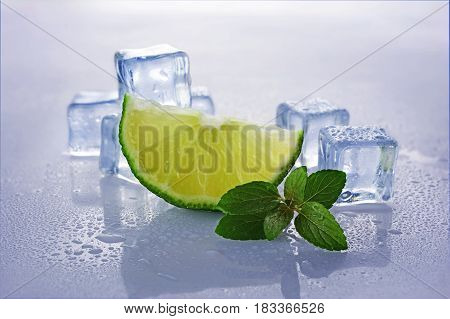 Blue Wet Ice Cube With Slice Of Lime And Mint