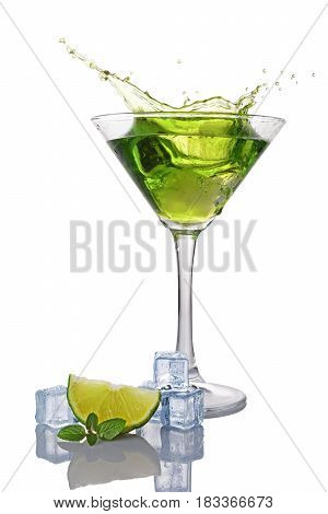 Splash In Glass Of Green Alcoholic Cocktail Drink With Lime, Mint And Ice Cube