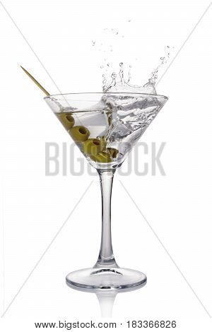 Splash In Martini Glass Of White Transparent Alcoholic Cocktail Drink With Olive