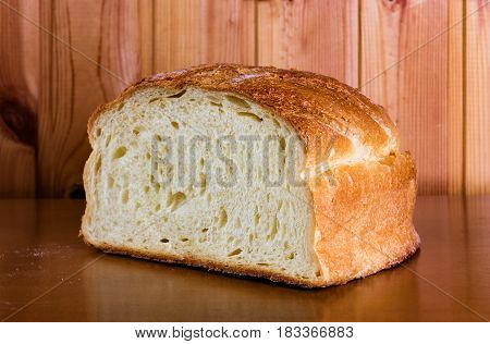 Fresh bread slice on wooden table. Selective focus