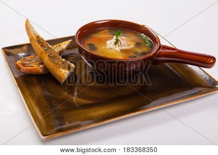 Chicken Soup And Bread On The White Background
