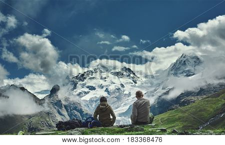 hikers on the trail in the Apls mountains. Trek near Matterhorn mount. Mountain ridge on the background