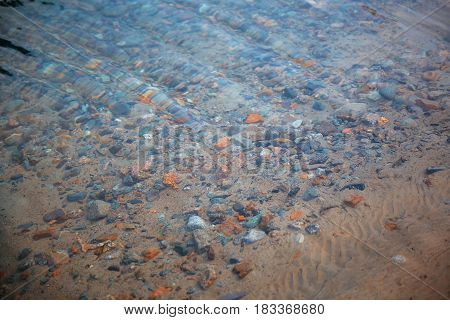 Underwater pebbles in the river. Close-up photo