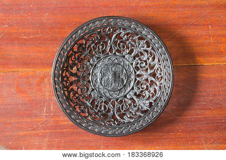 Beautiful Openwork Cast-iron Plate On An Old Wooden Table