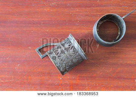 Two Old Metal Cup Holder On Old Wooden Table