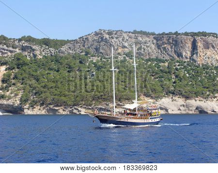 yacht with tourists in the sea cruise day