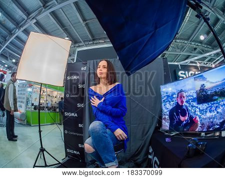 MOSCOW RUSSIA - APRIL 21 2017: Booth of Sigma company with workplace for testing lenses at PhotoForum 2017 trade show and exhibition in Moscow Russia on April 21 2017.