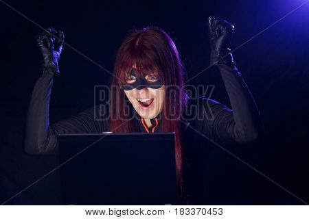 Hacker woman in black mask