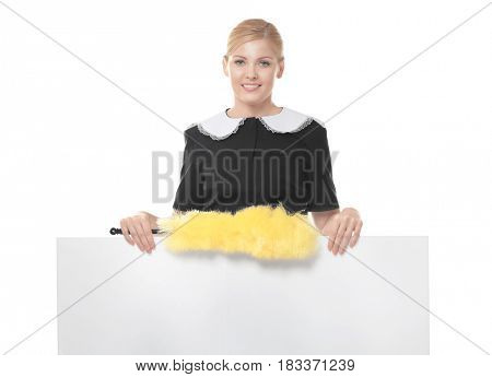 Beautiful chambermaid with yellow duster on white background