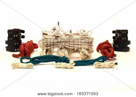 Selection of ropes and toys used in BDSM sexual games