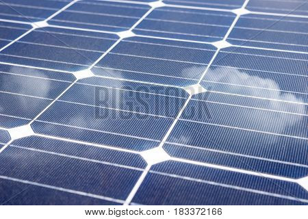 Solar Panel with reflection of blue sky and white clouds