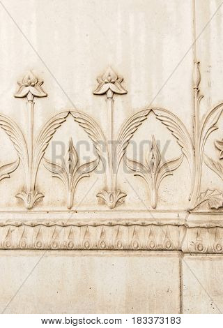 floral ornament carved in stone wall