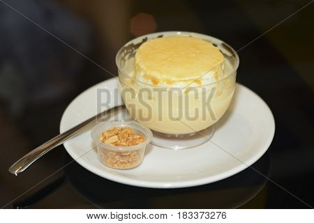 custard puddings flavored masticvanilla and saffron as background