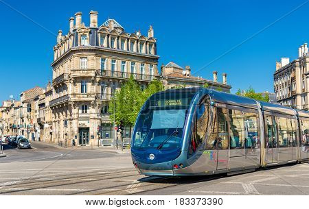 Bordeaux, France - April 9, 2017: City tram on Place de la Victoire. Bordeaux tram system has 66 km of lines and 116 stations