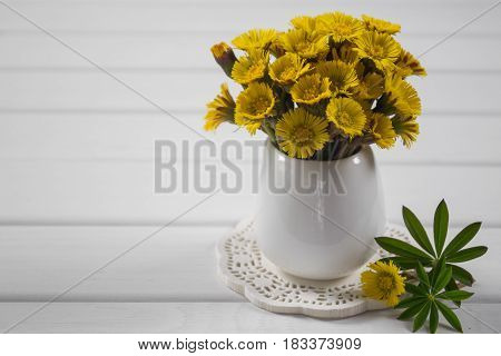 Bouquet of yellow spring flower on a white  background