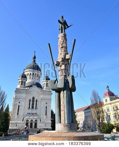 CLUJ NAPOCA ROMANIA - 04.01.2017: Archdiocesan Cathedral and Avram Iancu statue landmark architecture