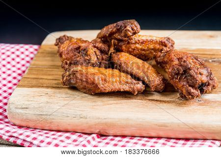delicious fried chicken wings with sauce