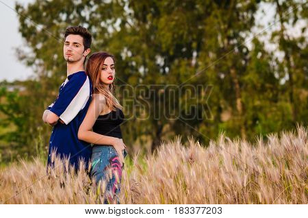 Portrait of a young couple in summer clothes outdoo