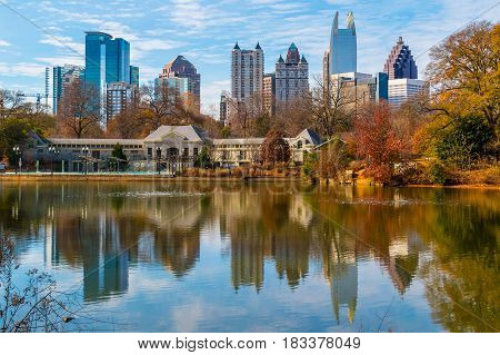 View of Lake Clara Meer Piedmont Park Aquatic Center and Midtown Atlanta in sunny autumn day USA