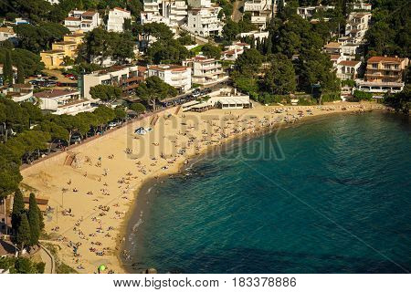 Aerial view of Canyelles beach in the city of Roses on the Costa brava at sunset