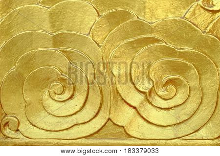 Gold Carved on Thai Temple Door Background.