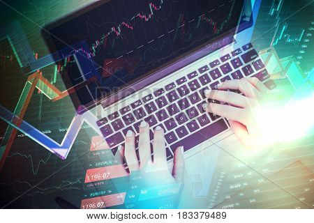 Money business technology and internet concept. Hands on keyboard.