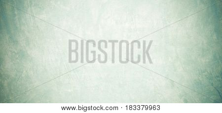 Blank grunge cement wall texture background banner green colored