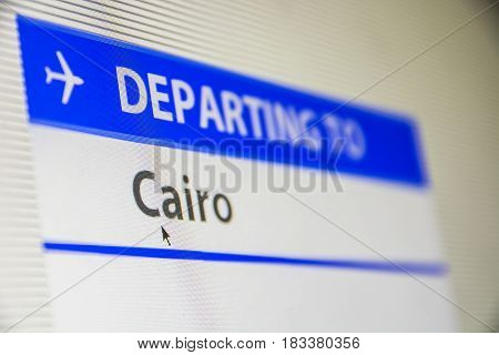 Computer screen close-up of status of flight departing to Cairo, Egypt