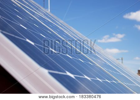 Alternative energy photovoltaic solar panels on roof of residential house