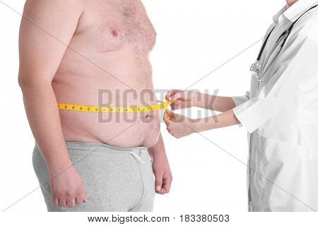 Female doctor measuring waist of fat man on white background. Weight loss concept