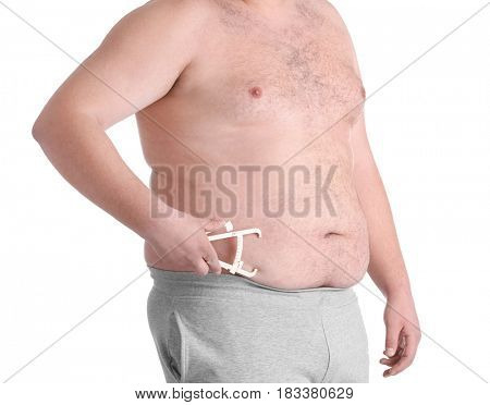 Fat man with measuring caliper on white background. Weight loss concept
