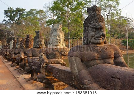 Stone carved statues of Devas on the bridge to Angkor Thom, Siem Reap, Cambodia