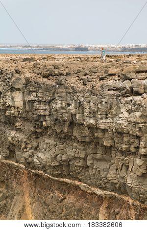 Tourist On Tall Cliff In Fuerteventura, Editorial