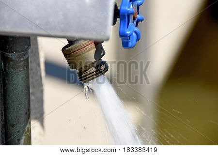 outdoor faucet with water flow and spray