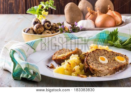 Photo Of Homemade Meatloaf With Small Quail Eggs