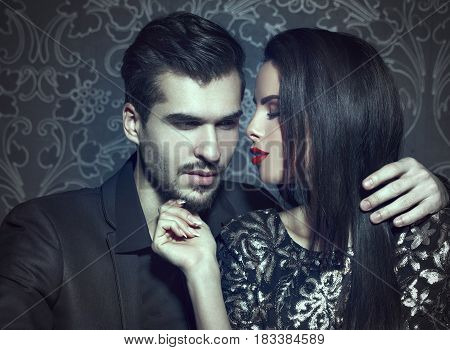 Romantic woman seducing young stylish rich man