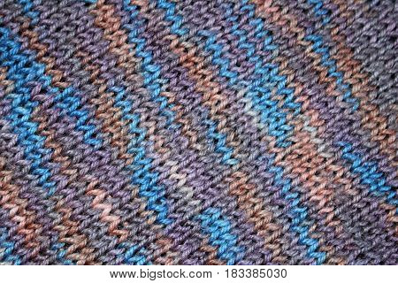 texture of the knitted fabric with striped pattern in blue tones