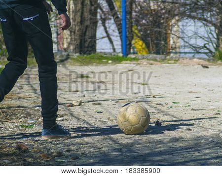 The soccer player's legs and soccer ball on the filed